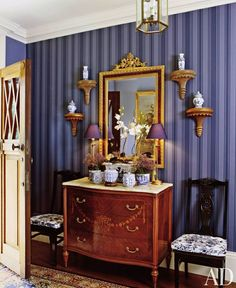 Love the modern striped purple wallpaper in this otherwise very traditional foyer renovated and decorated by Adele McGann.