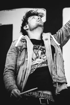 Dan Smith of Bastille, in his jean jacket and grey hoodie, with his boxers showing, gone with it