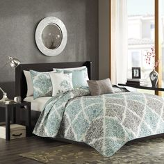 Spruce up your space with the Madison Park Claire Coverlet Set. This unique pattern has a small leaf print inside each diamond that makes up this crisscross design. Pops of dusty aqua give the perfect amount of color to add this collection into your neutral space. Three decorative pillows use embroidery and fabric manipulation for the perfect finishing touches to this collection.
