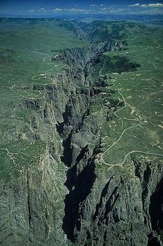 Aerial view of Black Canyon of the Gunnison, Gunnison County, Colorado. The Gunnison River, along with the forces of weathering, has sculpted this vertical wilderness of rock, water, and sky. Trails for all abilities are available on both South and North Rims.  http://www.pagosaspringsluxproperties.com