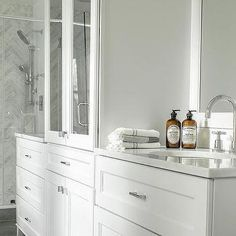 White Bathroom cabinets with marble Countertops - Contemporary - bathroom - MA Allen Interiors Taupe Bathroom, Marble Bathroom Accessories, White Marble Bathrooms, White Bathroom Cabinets, Condo Bathroom, Chic Bathrooms, Master Bathroom, Contemporary Bathrooms, Modern Bathroom