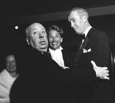 "Alfred Hitchcock with Jimmy and Gloria Stewart at the premiere of ""The Man Who Knew Too Much"" in Los Angeles, May 22, 1956."