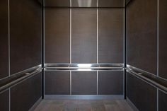 LEVELe-105 Elevator Interior in Bonded Bronze with Dark Patina and Charleston pattern; handrail panels in Stainless Steel with Satin finish; Round handrails in Satin Stainless Steel at Mills-Peninsula Hospital, Burlingame, California