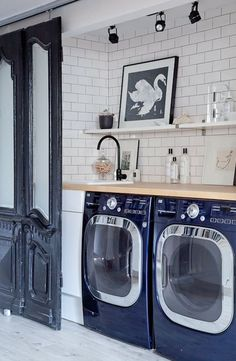 Subway tile from floor to ceiling, yes! 10+ Amazing Laundry Rooms - Classy Clutter