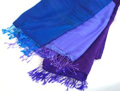 Fair trade handwoven polyester silk blend Water Pashminas from Nepal. Soft and silky, these wraps are 45cm x 195cm long and perfect for keeping the chill off your shoulders on a summers night. 12 fabulous iridescent colours to choose from..