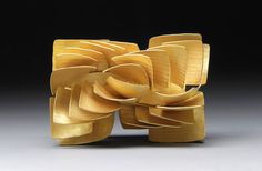 Jaqueline Ryan. Brooch: Structures of a Square - Half Spiral Brooch, 2016. 18ct gold.
