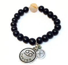 Zodiac Bracelet ~ Black wood beads and agate center stone with Cancer zodiac sign charm and hand stamped J-Tags logo charm in swivel. RETAILS for $28.50