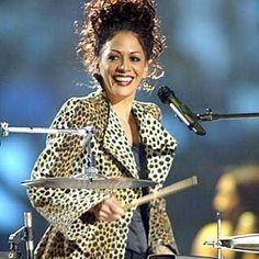 I was too embarrassed to ask for drum lessons in my adolescent years because I was a girl, & was from a small town. As I got older, she showed me you can be both...feminine, & a drummer...<3 Sheila E.
