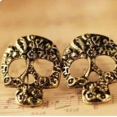 Skull studs Gold toned skull studs NWOT! Jewelry