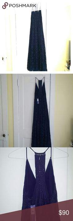 Rebecca Minkoff Navy lace, embroidered dress Rebecca Minkoff Navy lace and embroidered dress with Racerback braided back. V neck front and side zipper. Size 0 but fits loose and I am personally a size 4. Slip underneath that Hits above knee for a chic look. Hits right at ankle. Perfect for summer to go from day to night. Rebecca Minkoff Dresses Maxi