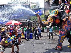 Songkran festival... Elephant joins the celebration with people on the street..