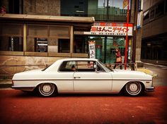 W114 Mercedes Benz 250c riding low in Tokyo