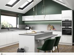 Crisp white gloss kitchen with plenty of storage. The high end design fits perfectly with the on trend deep green walls and the gold accents.  The contemporary three drop pendants and plush green dining chairs tie in with the luxurious walnut style flooring.