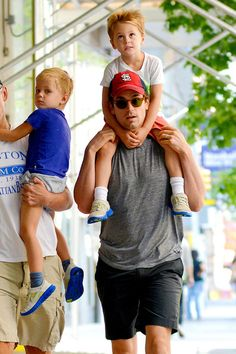 """White Collar"""" star Matt Bomer is spotted out for a stroll with his partner Simon Halls and their kids Henry, Walker, and Kit in Soho, New York City. The 34 year old actor publicly revealed he was gay in February of this year and later revealed he had three sons via surrogacy with his partner Halls, who works as a Hollywood publicist."""