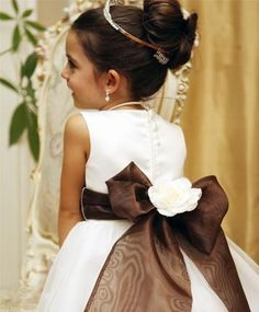 Planning on buying a simple flowergirl dress and making this sash with flower myself... much cheaper.
