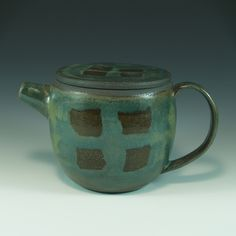 Wheel-thrown brown-black stoneware Dark turquoise and clear glaze; built-in strainer inside spout for leaf tea height - spout to handle - oz. Pottery Designs, Safe Food, Stoneware, Grid, Tea Pots, Mugs, Tableware, Blue, Cherry