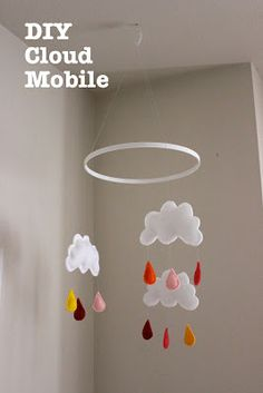 We G Three: DIY Cloud Mobile... 10 - 12 inch embroidery hoop painted to the specific color and felt and basic sewing. really solid tutorial. TONS less expensive then the etsy versions