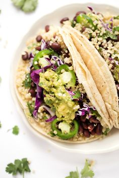 These healthy black bean quinoa tacos are the perfect recipe for summer! Cilantro-lime quinoa and fresh guacamole make these tacos light and flavorful!
