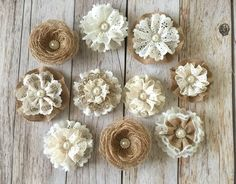 10 handmade burlap and lace rustic flowers by PinKyJubb on burlap and lace handmade flowers with metal rhinestone pearl buttons wedding cake, bridal bouquets, headbandsA personal favorite from my Etsy shop… Cloth Flowers, Burlap Flowers, Rustic Flowers, Diy Flowers, Fabric Flowers, Flores Shabby Chic, Shabby Chic Flowers, Material Flowers, Burlap Projects