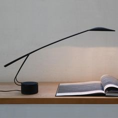 DOVE Table light with medium-flood beam, ideal as a task or as a reading light. Body in polycarbonate, arm supports in molibdenum steel. Painted in matt black. Double intensity switch.