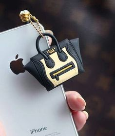Chanel. I need this!!! Too cute!
