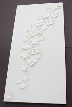 flower wall art - put directly on wall w/glue dots; use colored/printed cardstock to match room accents or mainly white w/ the purchased scrapbook paper flowers from michaels as an accent