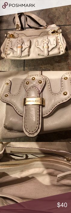 Michael Kors leather bag winter white, Older style Michael Kors leather bag! Winter white, bag has somewhere and bottom edges. There is this still a lot of life in this bad! Gold hardware, some staining inside. Thanks for looking!! Michael Kors Bags Satchels