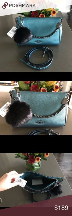 Coach Metallic Teal Carrie Crossbody & Cardholder New, authentic, and stunning! Both valued at $390. Pebbled leather, dark chrome colored chain and letters. Comes with fur ball charm and ID Cardholder. Has a removable shoulder strap. Coach gift box available upon request. Coach Bags Crossbody Bags