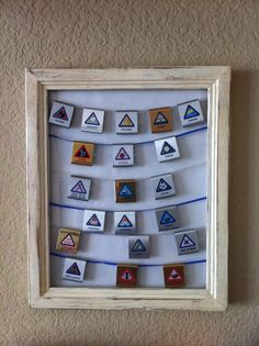Display for cub scout belt loops using a picture frame and boondoggle plastic string...but any type of sturdy string should work.