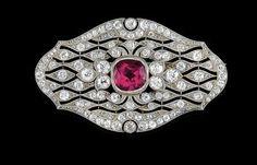 A diamond and rubellite brooch: platinum 950, white gold 750, brilliants, diamonds, some old-cut, diamond rhombs total weight c. 4.70 ct, tourmaline c. 3.50 ct, workmanship c. 1920/30, 15.4 g