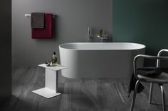 Freestanding bathtub, made of Sentec solid surface, with integrated overflow and feet Laufen Bathroom, Bathroom Sets, Complete Bathrooms, Swiss Design, Patricia Urquiola, Bathroom Collections, Eclectic Design, Solid Surface, Bathroom Furniture