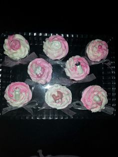 Baby bottles, booties, carriages and flowers ... cupcakes with chocolate decorations ...
