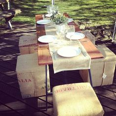 Outdoor garden table setting using timber trestle table, hessian ottoman stools and hessian table runner by Brandition. Www.brandition.com.au