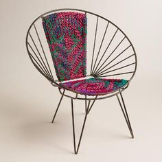 This eclectic chair was handmade in Jodhpur, India, a city notorious for its highly skilled artisans using Chindi. Chindi is a sustainable design tradition that repurposes leftover fabric into practical home items. Showcasing a traditional diamond weave pattern that celebrates India's colorful culture, this vibrant piece livens up any indoor space.