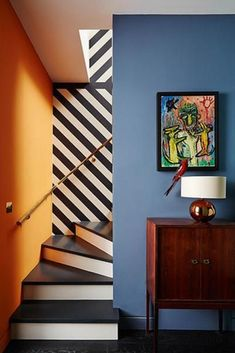Don't be afraid to use bold colours in geometric shapes to add depth and dimension. #dimensions #depth #hallway #hallwayideas #geometricideas #hallwaydesign #staircase Lobby Design, Interior Rugs, Interior Design Living Room, Room Colors, Wall Colors, Staircase Design, Staircase Ideas, Open Staircase, Interior Staircase