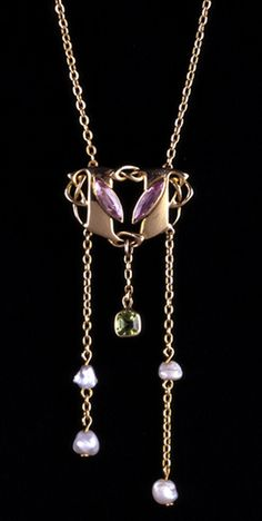 Liberty & Co. - ARCHIBALD KNOX (1864-1933) LIBERTY & Co. 'SUFFRAGETTE PENDANT'. A gold pendant set purple (violet) tourmalines with green peridot and pearl drops. The peridot was an addition to the original drawing to complete the colours.  English. Circa 1900.