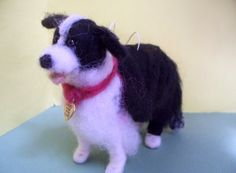 This 4 Needle Felted Border Collie is one of my new dogs for 2012. He is strung for hanging and a tag is attached with my company name and it is