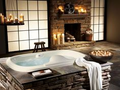 stone batrhroom design with fireplace...serenity...that's my kind of bathroom :)