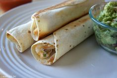 Pollo Fundido Chicken Flautas. Creamy chicken, cheese and spices all wrapped up and baked until golden brown and crispy!
