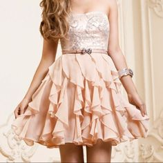 Really pretty baby-pink dress w/ lace and a layered skirt!