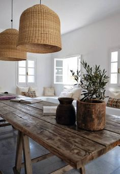 Wonderful rustic table with two bamboo or wicker woven pendant lamps! LOVE the rustic table against the cool white walls and ceiling! Must find small olive trees for garden pots! Villa Design, House Design, Design Hotel, Basket Lighting, Lighting Ideas, Neon Lighting, House Lighting, Ceiling Lighting, Sweet Home