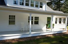 LOVE this porch. no stairs (walk-up), green front door, white exterior, gray floor