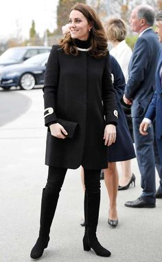 Kate is wearing a black GOAT coat with gold details with black suede boots. I love the coat!