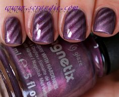 Lovin' this new China Glaze Magnetic Nail Polish! I wish I could get it to look like hers!