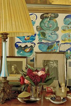WSJ: Members Only  A look inside Robin Birley's exclusive, exotic new London club.    FAMILY ROOM | Robin's nightstand with a picture of his grandmother, Rhoda Birley, propped behind a lamp. The cartoon behind the photos was bought at auction.