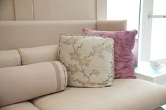 Pink throw pillows with soft pink dogwood print fabric and dark pink velvet throw pillow decorating with soft pink colors.