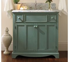 Maybe something similar to this color would work on our bathroom cabinets?