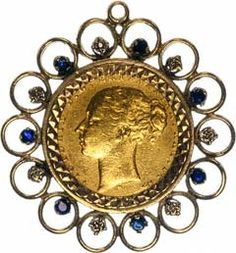 Diamond and sapphire fancy pendant mount featuring an 1897 Victoria Young Head sovereign. Coin in mount £295.00