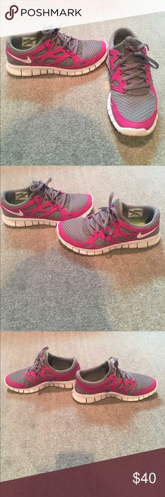 Nike Free Run 2 Women's Nike Free Run 2 shoe. Grey in color with purple details. Used but still in great condition. Never worn to work out in, only for casual wear. Women's size 9. Open to offers Nike Shoes Athletic Shoes