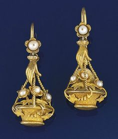 A pair of 19th century Russian gold and seed pearl earpendants  Each modelled as a hanging basket of flowers with seed pearl flowerheads, trailing ivy and engraved detail, suspended from a modelled hand to seed pearl flowerhead terminals, circa 1880, Russian marks to loops